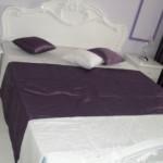 Текстиль для спальни в сиреневых тонах от салона штор Декория